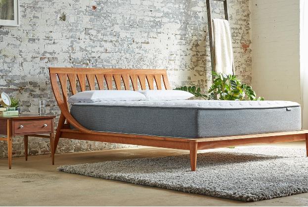back sleeper innerspring mattress aviya in a bedroom setting