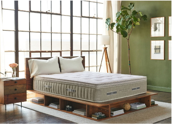Brentwood cedar hybrid mattress for back sleepers in a bedroom setting.