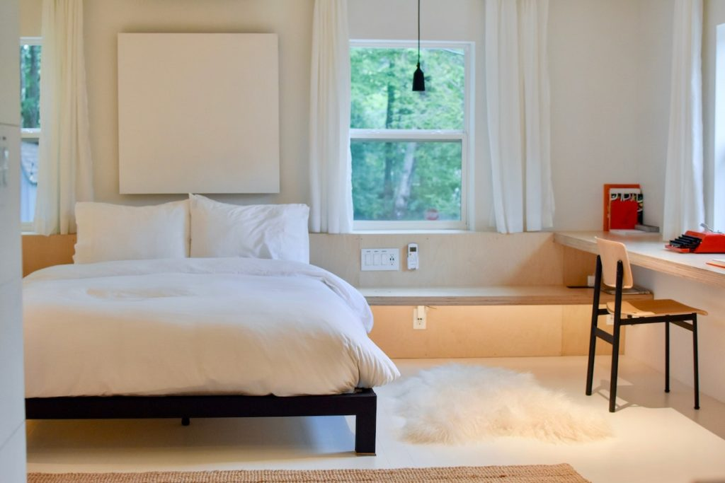Bed in a white bedroom